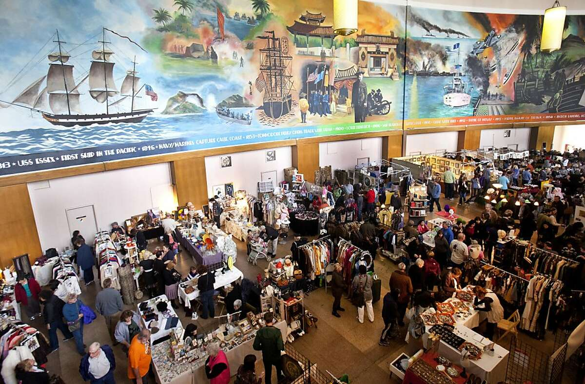 Vendors and shoppers fill the Administration Building on Treasure Island on Sunday for the last indoor flea market of the season. Dozens of vendors crammed into the Administration Building at Treasure Island in San Francisco on Sunday to sell hand-crafted and unique goods during the final day of the Treasure Island Flea Market indoors season.