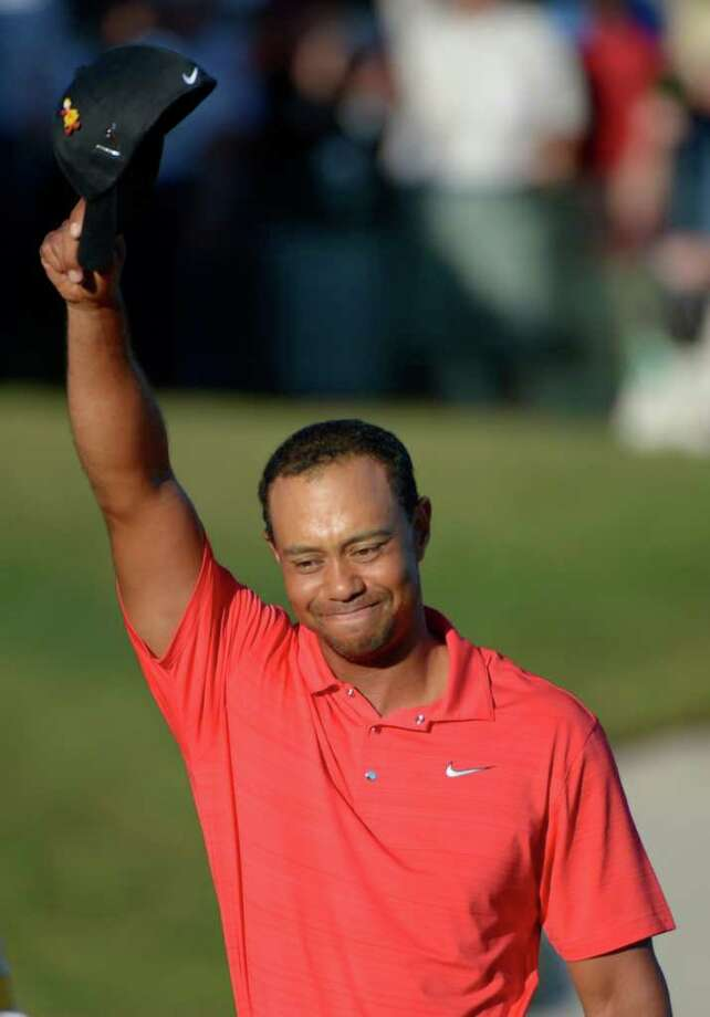 Tiger Woods waves his hat to the crowd after winning the Arnold Palmer Invitational golf tournament at Bay Hill in Orlando, Fla., Sunday, March 25, 2012. (AP Photo/Phelan M. Ebenhack) Photo: Phelan M. Ebenhack