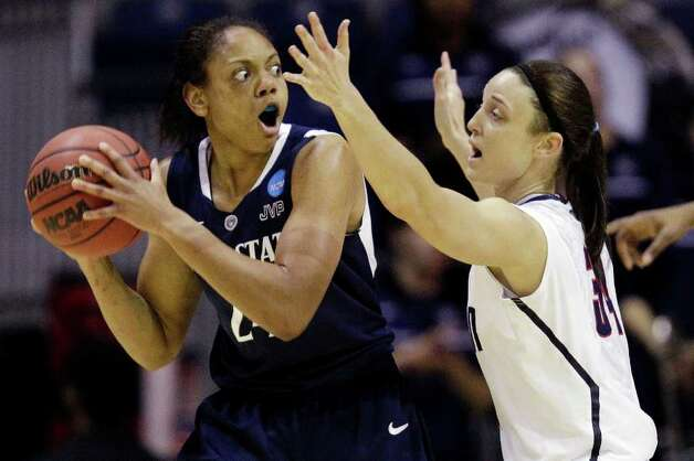 Penn State forward Mia Nickson (24) looks for an outlet around Connecticut center Stefanie Dolson (31) during the first half of their NCAA women's tournament regional semifinal college basketball game in Kingstown, R.I., Sunday, March 25, 2012. (AP Photo/Stephan Savoia) Photo: Stephan Savoia, Associated Press / AP