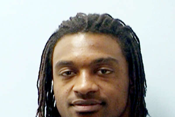 This booking photo provided by the Austin Police Department shows Cedric Benson photographed in Austin, Texas on Wednesday, Aug. 30 2011. The Cincinnati running back has begun serving a 20-day jail term in Texas to settle two misdemeanor assault cases. (AP Photo/Austin Police Department)
