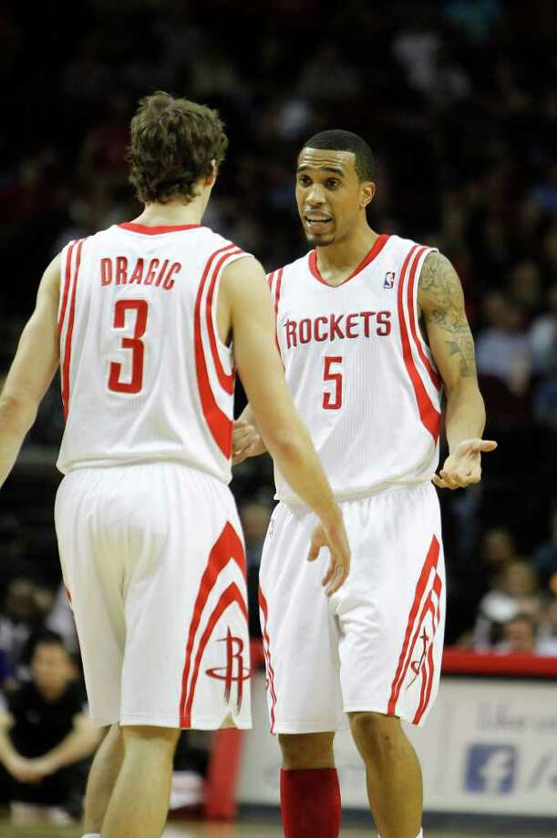 Rockets guards Goran Dragic, left, and Courtney Lee are forced to play more minutes, with mixed results. Photo: Karen Warren / © 2012  Houston Chronicle