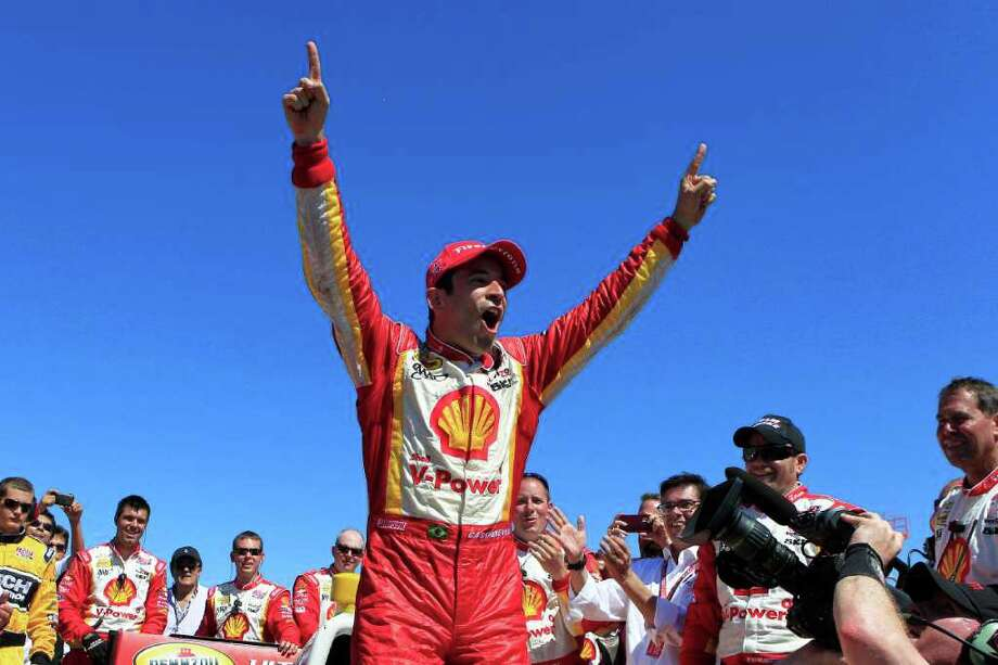 Helio Castroneves celebrates winning the IndyCar season opener. Photo: MIchael L. Levitt / AP2012