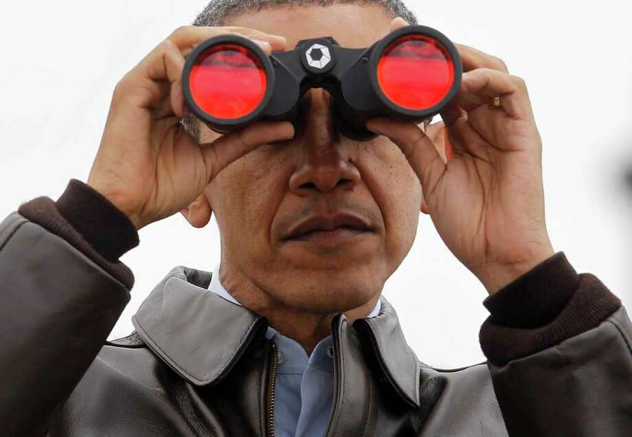 President Barack Obama peers at North Korea on Sunday from Observation Post Ouellette in the Demilitarized Zone in Panmunjom, South Korea. Photo: Pablo Martinez Monsivais / AP