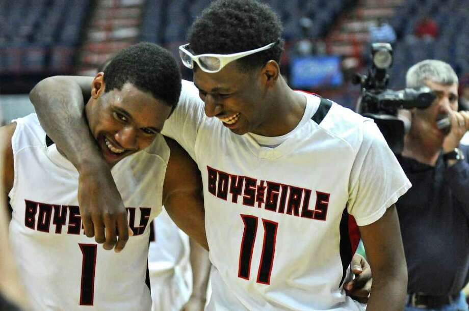 Boys and Girls High School basketball players Leroy Fludd, left, and Shakur Pinder, right, celebrate after their 66-60 victory over Mount Vernon in the Class AA final of the New York State Federation tournament at the Times Union Center,  on Sunday March 25, 2012 in Albany, NY. Fludd was the tournament MVP.  (Philip Kamrass / Times Union ) Photo: Philip Kamrass / 00016932A