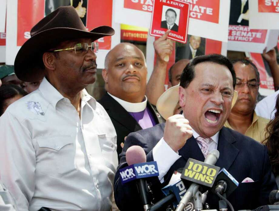 New York state Senate majority leader Pedro Espada Jr., right, accompanied by state Sen. Ruben Diaz, left, speaks during a sidewalk news conference as he rejected efforts by New York Democratic leaders to oust him from the party in the Bronx borough of New York,  Monday, July 12, 2010. Espada vowed at the news conference  to run again this fall as a Democrat and suggested the party's efforts were racially motivated. (AP Photo/Richard Drew) Photo: Richard Drew / AP