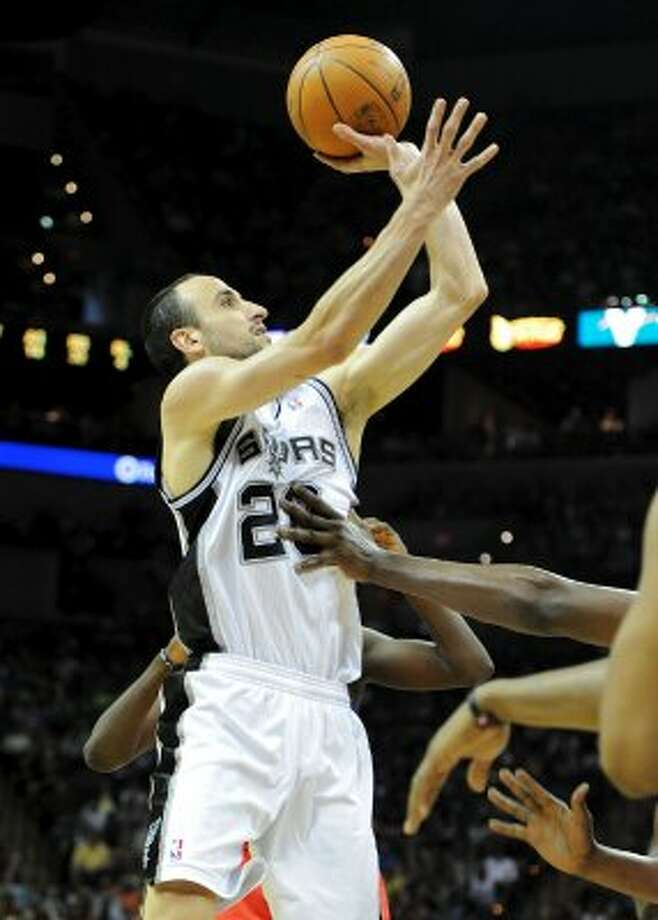 San Antonio Spurs shooting guard Manu Ginobili (20) puts up a shot during a NBA basketball game between the Philadelphia 76ers and the San Antonio Spurs at the AT&T Center in San Antonio, Texas on March 25, 2012.