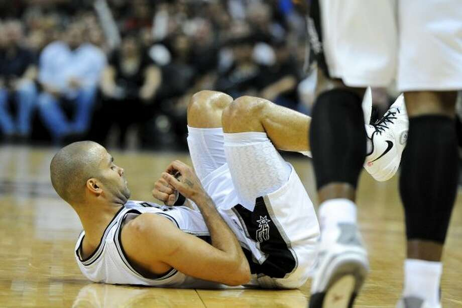 San Antonio Spurs point guard Tony Parker (9) looks at his hand after a hard foul during a NBA basketball game between the Philadelphia 76ers and the San Antonio Spurs at the AT&T Center in San Antonio, Texas on March 25, 2012. John Albright / Special to the Express-News. (JOHN ALBRIGHT / San Antonio Express-News)