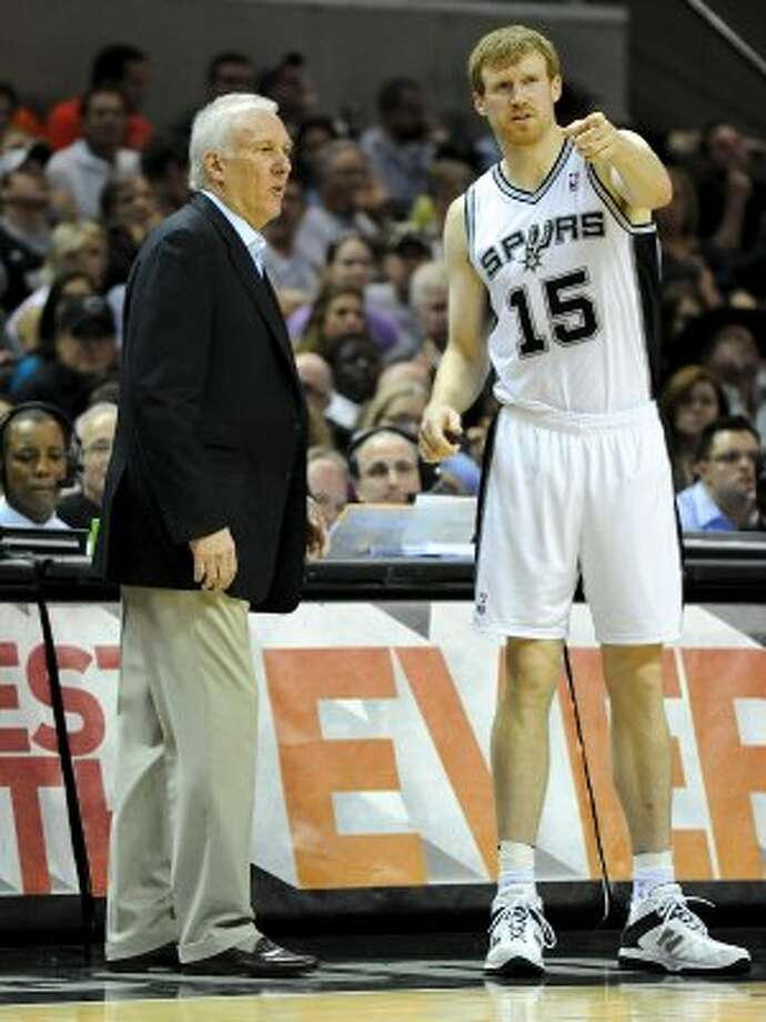 San Antonio Spurs head coach Gregg Popovich talks with San Antonio Spurs power forward Matt Bonner (15) during a NBA basketball game between the Philadelphia 76ers and the San Antonio Spurs at the AT&T Center in San Antonio, Texas on March 25, 2012.