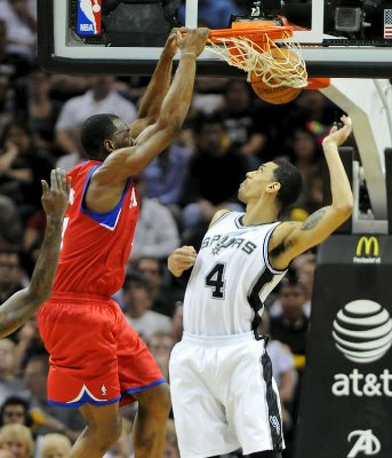 Philadelphia 76ers small forward Sam Young (7) dunks over San Antonio Spurs guard Daniel Green (4) during a NBA basketball game between the Philadelphia 76ers and the San Antonio Spurs at the AT&T Center in San Antonio, Texas on March 25, 2012.