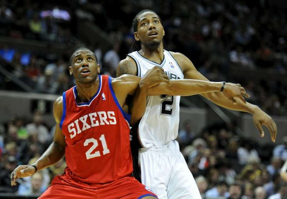 Philadelphia 76ers forward Thaddeus Young (21) blocks out San Antonio Spurs small forward Kawhi Leonard (2) during a NBA basketball game between the Philadelphia 76ers and the San Antonio Spurs at the AT&T Center in San Antonio, Texas on March 25, 2012.
