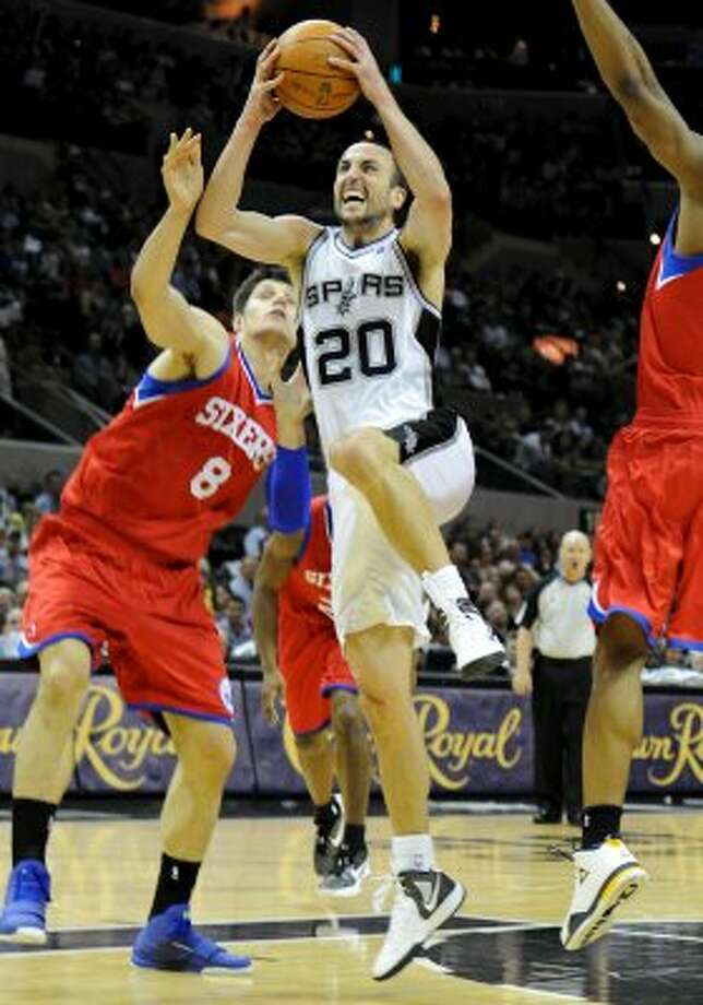 San Antonio Spurs shooting guard Manu Ginobili (20) goes up for a shot during a NBA basketball game between the Philadelphia 76ers and the San Antonio Spurs at the AT&T Center in San Antonio, Texas on March 25, 2012. John Albright / Special to the Express-News. (JOHN ALBRIGHT / San Antonio Express-News)