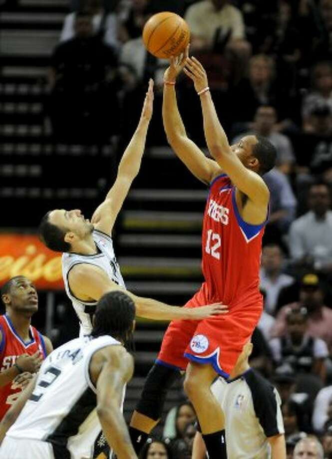 San Antonio Spurs shooting guard Manu Ginobili (20) guards Philadelphia 76ers shooting guard Evan Turner (12) as he takes a shot during a NBA basketball game between the Philadelphia 76ers and the San Antonio Spurs at the AT&T Center in San Antonio, Texas on March 25, 2012. John Albright / Special to the Express-News. (JOHN ALBRIGHT / San Antonio Express-News)