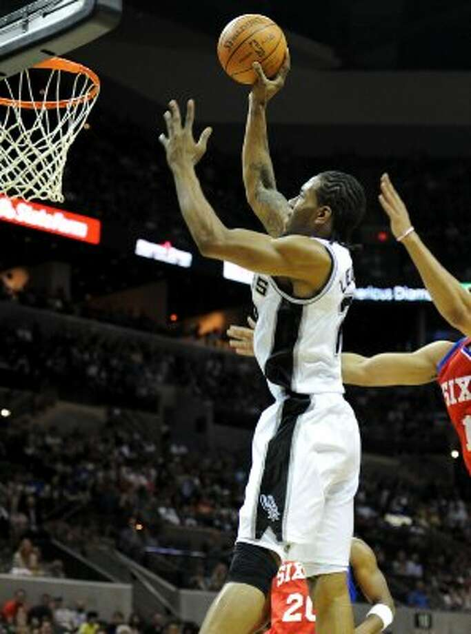 San Antonio Spurs small forward Kawhi Leonard (2) puts up a shot during a NBA basketball game between the Philadelphia 76ers and the San Antonio Spurs at the AT&T Center in San Antonio, Texas on March 25, 2012.