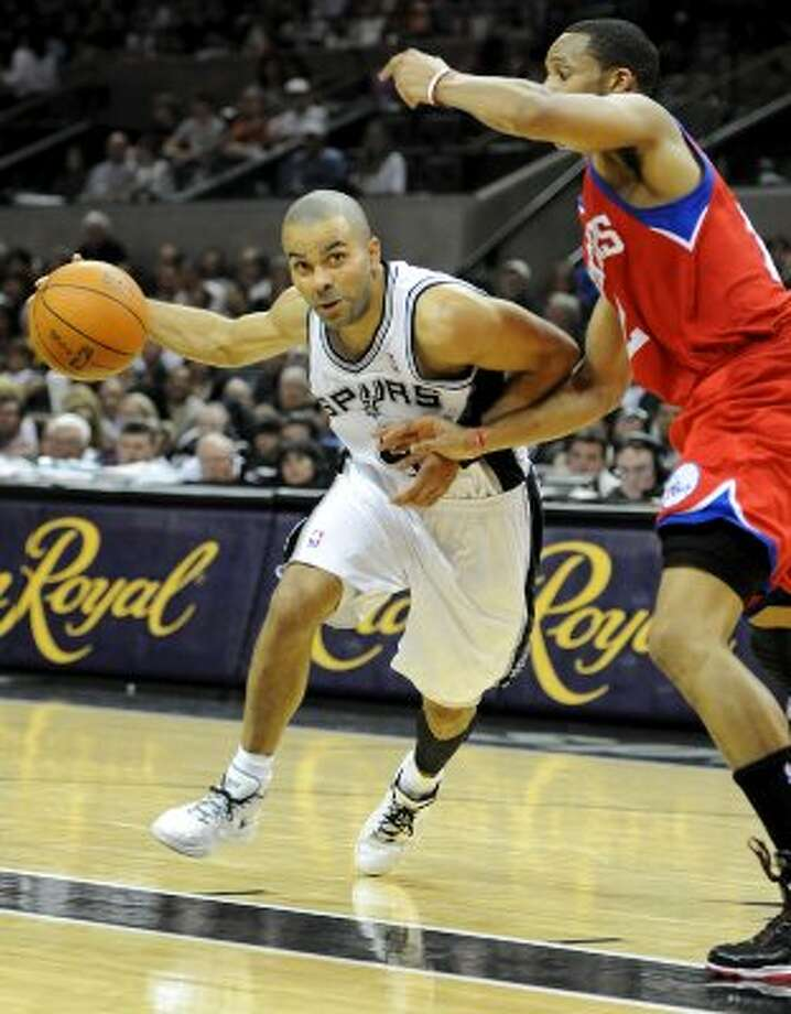 San Antonio Spurs point guard Tony Parker (9) drives to the basket during a NBA basketball game between the Philadelphia 76ers and the San Antonio Spurs at the AT&T Center in San Antonio, Texas on March 25, 2012.