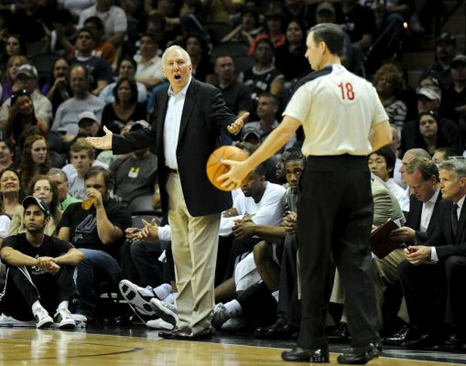 San Antonio Spurs head coach Gregg Popovich argues a call during a NBA basketball game between the Philadelphia 76ers and the San Antonio Spurs at the AT&T Center in San Antonio, Texas on March 25, 2012.