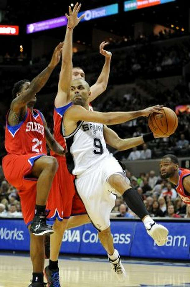 San Antonio Spurs point guard Tony Parker (9) looks to pass the ball during a NBA basketball game between the Philadelphia 76ers and the San Antonio Spurs at the AT&T Center in San Antonio, Texas on March 25, 2012.
