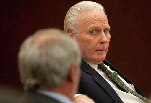 Carl Wayne Buntion looks at his attorneys before during closing arguments in his sentencing retrial at the Harris county Criminal Justice Center Monday, March 5, 2012, in Houston. Buntion fatally shot a a Houston police officer more than 20 years ago. Photo: Cody Duty, Houston Chronicle / © 2011 Houston Chronicle