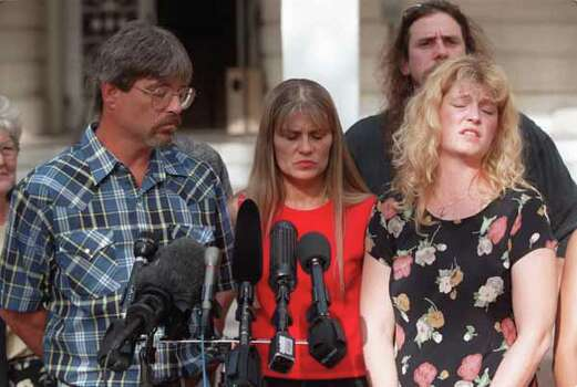 Members of the Moseley family reflect on the Johnny Paul Penry verdict to the media, left to right, Tim Moseley, his wife Hope and Ellen Moseley May, Wednesday, July 3, 2002, in Conroe, Texas. A Texas jury rejected arguments that Penry was mentally retarded and sentenced him to death on Wednesday. Penry has twice escaped previous death sentences. The U.S. Supreme Court overturned the sentences in 1989 and June 2001. CHRISTOBAL PEREZ/HOUSTON CHRONICLE Photo: Christobal Perez, Wire / Houston Chronicle