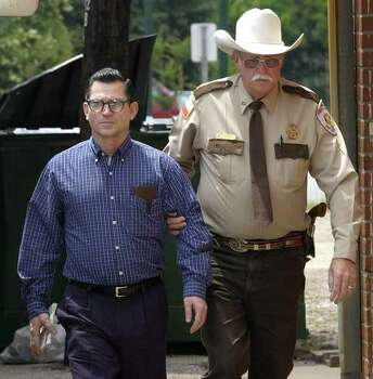 Convicted killer Johnny Paul Penry, left, is escorted by Polk County Sheriff's Deputy Richard Bailey for the start of jury selection for Penry's sentencing Monday, April 29, 2002, in Conroe, Texas. Penry has twice been sentenced to death and twice his sentence has been overturned by the U.S. Supreme Court, most recently last year. In its latest ruling in his case, however, the high court let his murder conviction stand, meaning jurors who began assembling Monday will be considering testimony only on whether Penry deserves life in prison or lethal injection for the rape and murder of Pamela Moseley Carpenter more than 22 years ago. (AP Photo/David J. Phillip)   HOUCHRON CAPTION (06/25/2002):  Penry. Photo: DAVID J. PHILLIP, Wire / AP