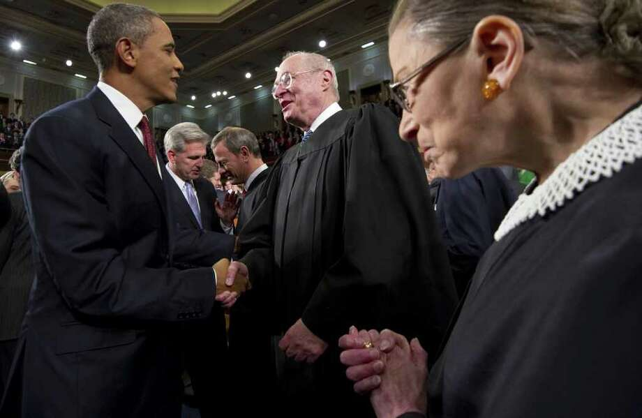 FILE - In this Jan. 24, 2012, file photo President Barack Obama greets Supreme Court Justice Anthony Kennedy and Ruth Bader Ginsburg, right, prior to his State of the Union address in front of a joint session of Congress at the Capitol in Washington. The monumental fight over a health care law that touches all Americans and divides them sharply comes before the Supreme Court Monday, March 26, 2012.  (AP Photo/Saul Loeb, Pool, File) Photo: SAUL LOEB