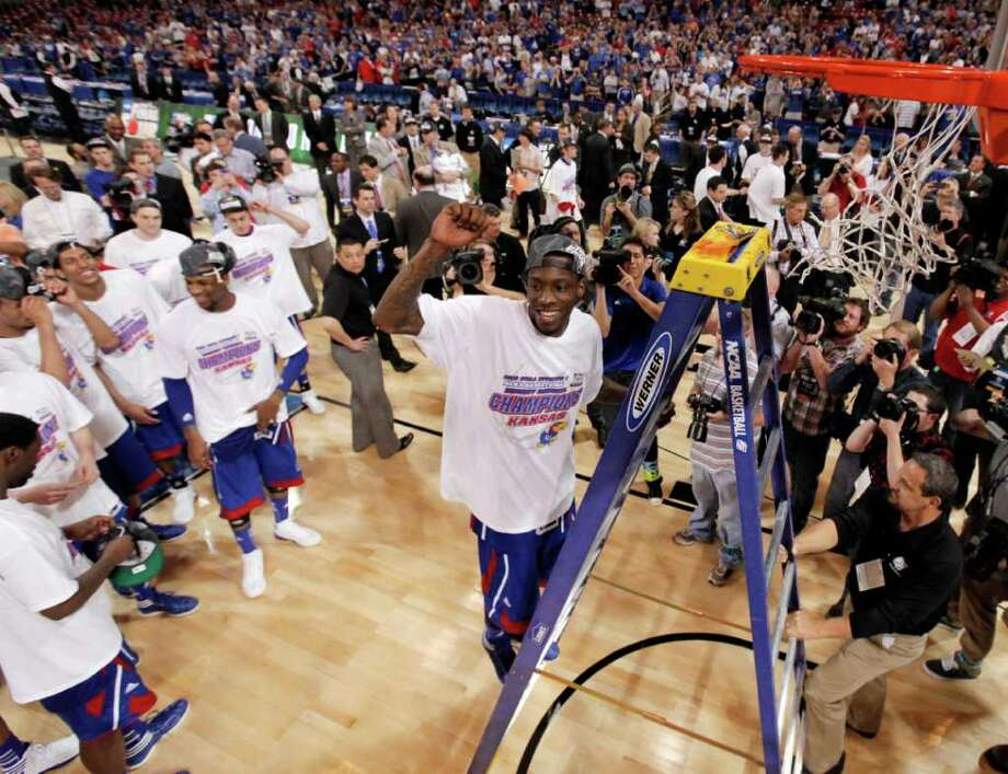 Kansas guard Tyshawn Taylor celebrates as he goes up on the ladder to cut the net after Kansas defeated North Carolina 80-67 in the NCAA men's college basketball tournament Midwest Regional final Sunday, March 25, 2012, in St. Louis. (AP Photo/Charlie Riedel) Photo: Charlie Riedel