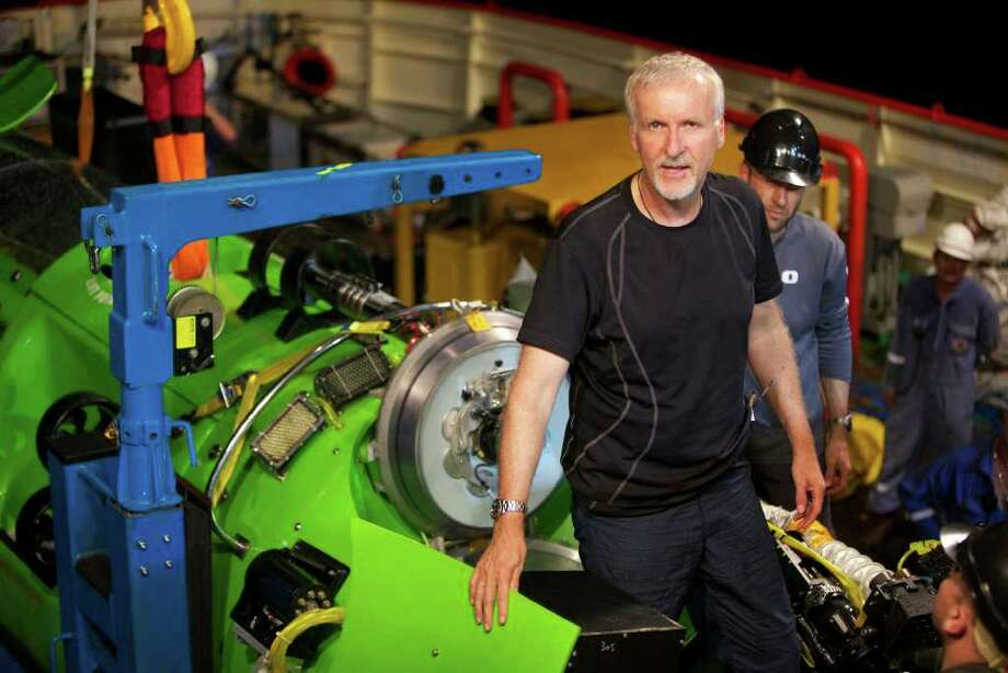 This February 2012 photo, provided by National Geographic, shows explorer and filmmaker James Cameron emerging from the hatch of DEEPSEA CHALLENGER during testing of the submersible in Jervis Bay, south of Sydney, Australia. Director James Cameron began his journey Sunday, March 25, 2012, to someplace only two men have gone before ? to the Earth's deepest point. (AP Photo/National Geographic, Mark Thiessen) Photo: Mark Thiessen / Copyright 2012 The Associated Press. All rights reserved. This material may not be published, broadcast, rewritten or redistribu