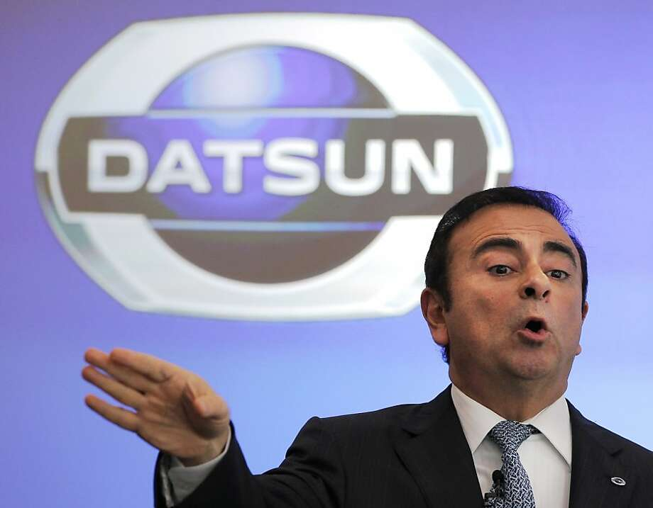 "Nissan Motor Co. Chief Executive Carlos Ghosn speaks during a news conference on the company's brand ""Datsun"" at its head office in Yokohama, near Tokyo, Wednesday, March 21, 2012. Nissan is reviving Datsun models in emerging markets, where the biggest growth is expected for affordable stylish vehicles, and has no plans to bring the brand back in developed markets, Ghosn said Wednesday. (AP Photo/Itsuo Inouye) Photo: Itsuo Inouye, Associated Press"