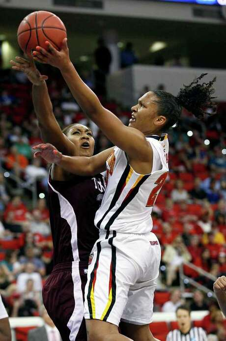 Maryland's Alyssa Thomas drives to the basket for two of her 21 points as Texas A&M's Karla Gilbert defends in the first half Sunday. Photo: Gerry Broome / AP
