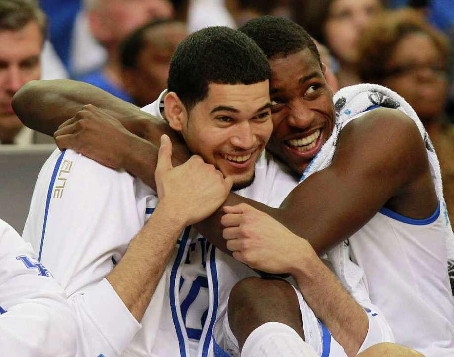 Kentucky's Eloy Vargas, left and Kentucky's Darius Miller reacts in the closing seconds of the second half of an NCAA tournament South Regional finals college basketball game against Baylor Sunday, March 25, 2012, in Atlanta. Kentucky won 82-70. (AP Photo/John Bazemore) Photo: John Bazemore