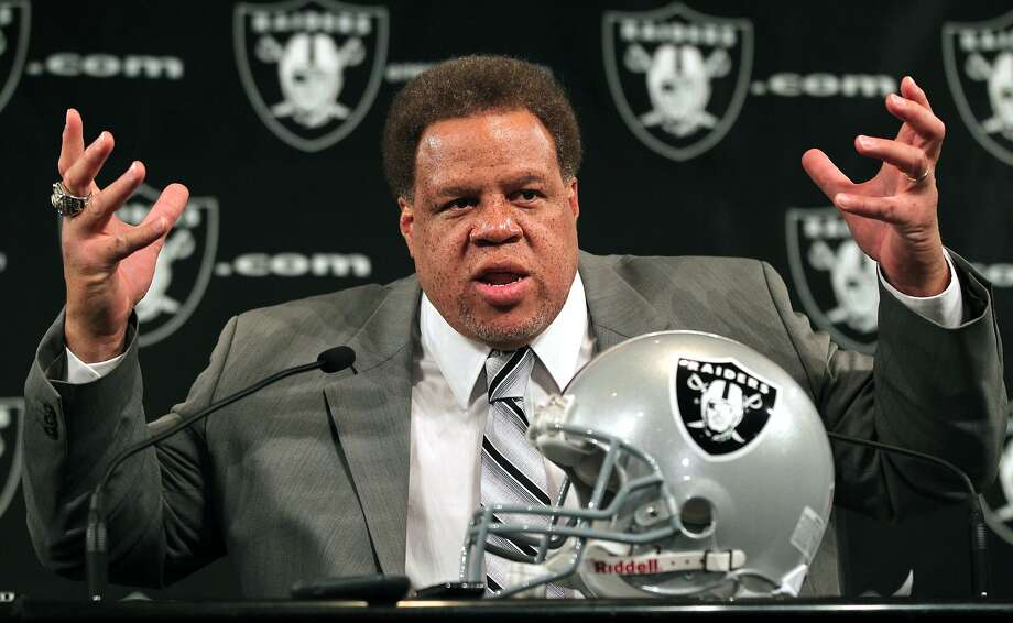 The Oakland Raiders new GM Reggie McKenzie, wearing a Super Bowl ring, gestures during a press conference where he was introduced to the media Tuesday, January 10, 2012. McKenzie's first official act was to fire coach Hue Jackson, after the team went 8-8 this past season. Photo: Lance Iversen, The Chronicle