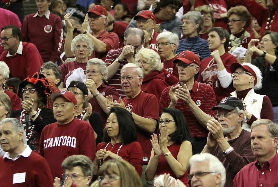 Stanford fans celebrate their teams 76-60 win over South Carolina in an NCAA women's tournament regional semifinal college basketball game,  Saturday, March 24, 2012, in Fresno, Calif. Stanford plays Duke Monday in the regional finals.(AP Photo/Rich Pedroncelli) Photo: Rich Pedroncelli, Associated Press