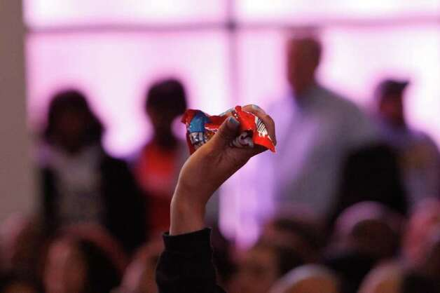 A woman holds up a bag of Skittles during a rally against the shooting death of unarmed Florida teenager Trayvon Martin. The teenager only had Skittles and iced tea when he was fatally shot. Photo: JOE DYER / SEATTLEPI.COM