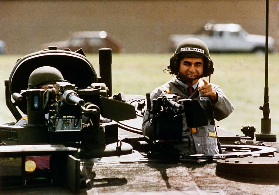 FILE - In this Sept. 13, 1988, file photo Democratic presidential candidate Michael Dukakis gets a free ride in a new M1-A-1 battle tank during a visit to General Dynamics in Sterling Heights, Mi., where he told workers he's not soft on defense. The image of a helmeted Dukakis taking a spin in a tank proved to be the ultimate in What Not To Wear for a presidential candidate during his run, his loosing run, for the presidency against President George H.W. Bush. ( AP Photo/Michael E. Samojeden, File) Photo: Michael E. Samojeden, AP