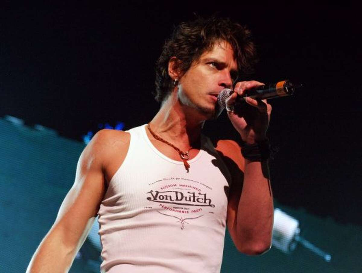 Chris Cornell in 2002, performing with Audioslave in Los Angeles. (Kevin Winter / Getty Images)
