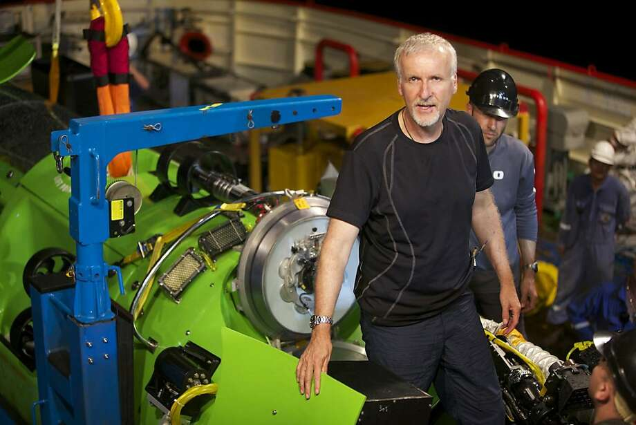 """FILE - This February 2012 file photo provided by National Geographic, shows explorer and filmmaker James Cameron emerging from the hatch of DEEPSEA CHALLENGER during testing of the submersible in Jervis Bay, south of Sydney, Australia. Cameron on Sunday, March 25, 2012 began his journey  to someplace only two men have gone before — to the Earth's deepest point. The director of """"Titanic,"""" ''Avatar"""" and other films is using the specially designed submarine to descend nearly seven miles (11 kilometers) to the bottom of the Mariana Trench, an area 200 miles (320 kilometers) southwest of the Pacific island of Guam. (AP Photo/National Geographic, Mark Thiessen, File) Photo: Mark Thiessen, Associated Press"""
