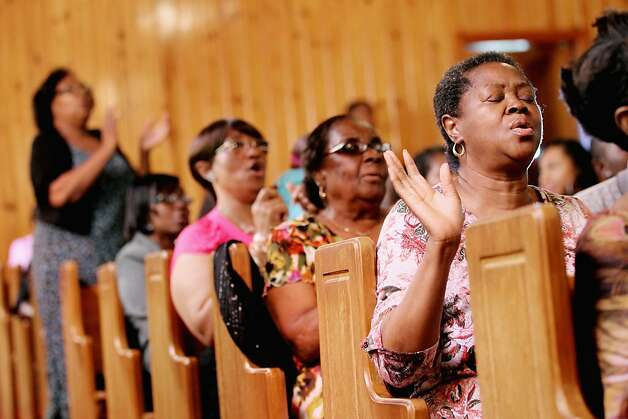 SANFORD, FL - MARCH 25:  Parishioners worship at Allen Chapel AME Church on March 25, 2012 in Sanford, Florida. The church held a prayer vigil for Trayvon Martin on March 22. Black teenager Trayvon Martin was killed by white and hispanic man George Michael Zimmerman while on neighborhood watch patrol in Sanford. Rev. Jesse Jackson will lead a march in Sanford tomorrow.  (Photo by Mario Tama/Getty Images) Photo: Mario Tama, Getty Images