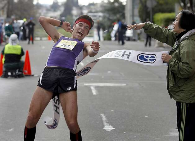 Oakland Mayor Jean Quan (right) congratulated marathon winner Chris Mocko of San Francisco. The Oakland Running Festival avoided the rain at the start of the marathon Sunday March 25, 2012. Photo: Brant Ward, The Chronicle
