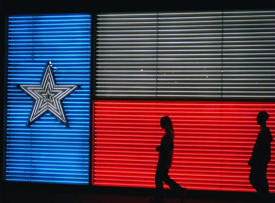 An 11-by-18-foot neon Texas flag greets visitors to the Institute of Texan Cultures, a museum that explores the contributions of the many ethnic groups that settled in the state. (Judith Evans/St. Louis Post-Dispatch/MCT) Photo: Judith Evans, McClatchy-Tribune News Service