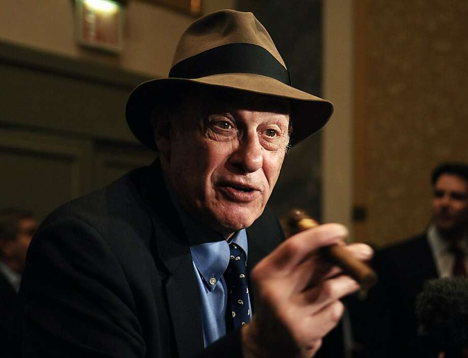 In this file photo taken Oct. 28, 2005, boxing historian Bert Sugar is seen at the Friars Club Roast in New York. Sugar, known for his fedora and cigar, has died. Jennifer Frawley, Sugar's daughter, said cardiac arrest caused his death on Sunday, March 25, 2012. His wife, Suzanne, was by his side when he passed away. (AP Photo/Louis Lanzano, file) Photo: Louis Lanzano, Associated Press