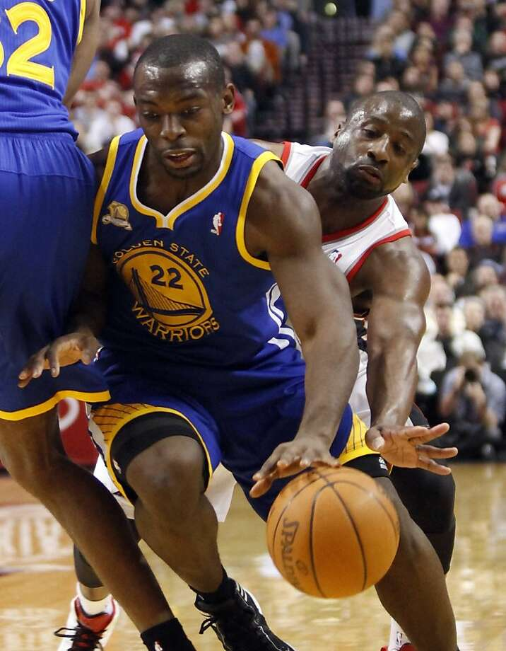 Portland Trail Blazers guard Raymond Felton, right, reaches in from behind as Golden State Warriors guard Charles Jenkins drives to the basket during the first quarter of their NBA basketball game in Portland, Ore., Sunday, March 25, 2012. (AP Photo/Don Ryan) Photo: Don Ryan, Associated Press
