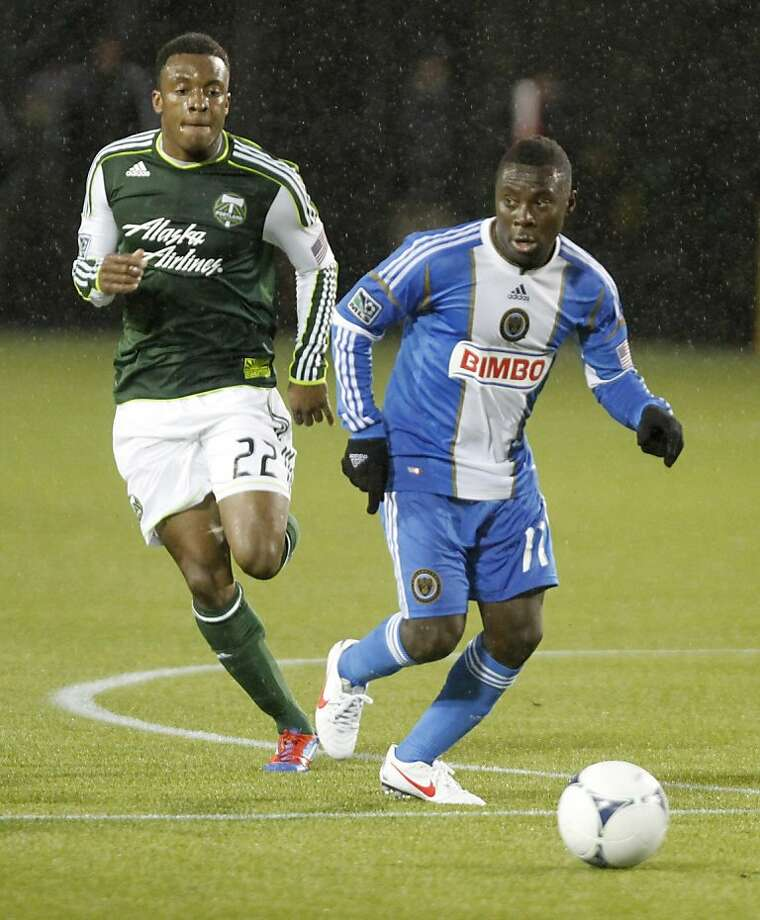 Philadelphia Union forward Freddy Adu, right, and Portland Timbers defender Rodney Wallace chase down the ball during the first half of their MLS soccer game in Portland, Ore., Monday, March 12, 2012.(AP Photo/Don Ryan) Photo: Don Ryan, Associated Press