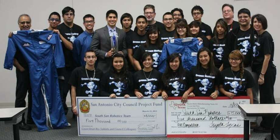 Pictured are District 4 Councilman Rey Saldaña, Toyota officials and the South San High School robotics team. Photo: Courtesy Photo