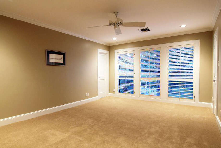 Although currently empty, this room could be used either as a bedroom or as an exercise room, game room or home theater. Photo: Realtor.com