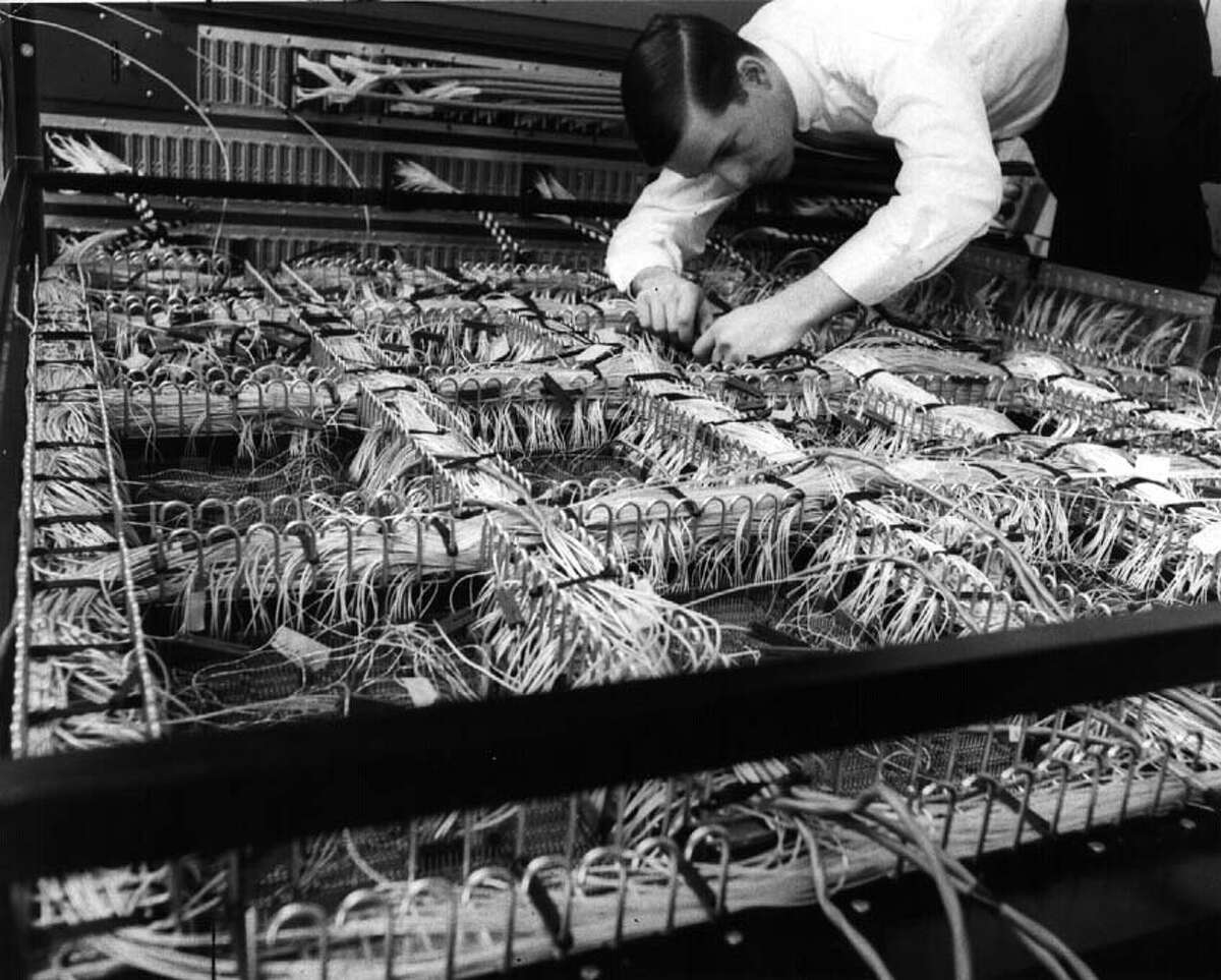 Work on an early computer in 1966 at IBM in White Plains, N.Y. (Times Union archive)