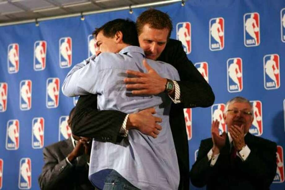 DALLAS - MAY 15: Dirk Nowitzki #41 (R) and owner Mark Cuban of the Dallas Mavericks embrace in front of the media during the Maurice Podoloff 2006-2007 NBA MVP Trophy award presentation on May 15, 2007 at the American Airlines Center in Dallas, Texas. NOTE TO USER: User expressly acknowledges and agrees that, by downloading and or using this photograph, User is consenting to the terms and conditions of the Getty Images License Agreement. Mandatory Copyright Notice: Copyright 2007 NBAE (Photo by Ned Dishman/NBAE via Getty Images) *** Local Caption *** Dirk Nowitzki;Mark Cuban (Ned Dishman / NBAE/Getty Images)