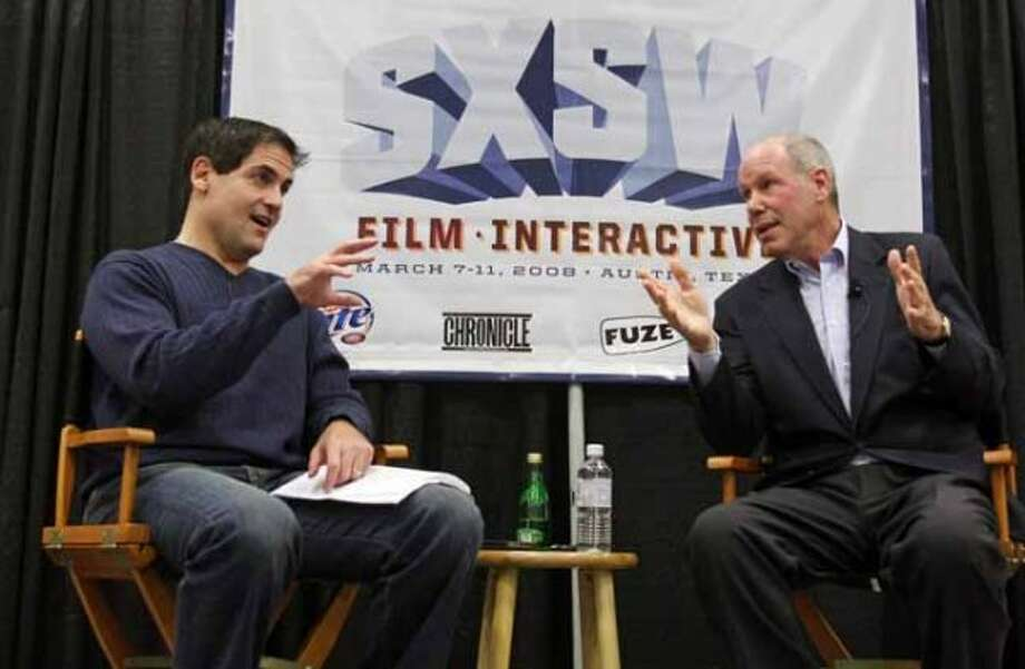 Former Disney chief Michael Eisner, right, and Dallas Mavericks owner Mark Cuban participate in a question and answer panel at the SXSW Film and Interactive Festival in Austin, Texas on Tuesday, March 11, 2008. (AP Photo/Jack Plunkett) (Jack Plunkett / AP)