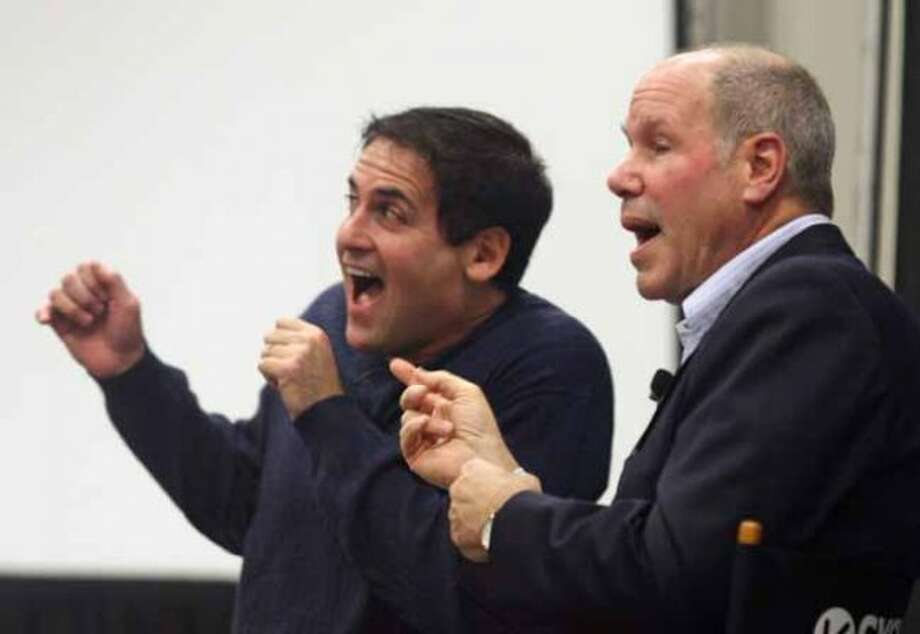 Former Disney chief Michael Eisner, right, and Dallas Mavericks owner Mark Cuban participate in a question and answer panel at the SXSW Film and Interactive Festival in Austin, Texas on Tuesday, March 11, 2008.(AP Photo/Jack Plunkett) (Jack Plunkett / AP)