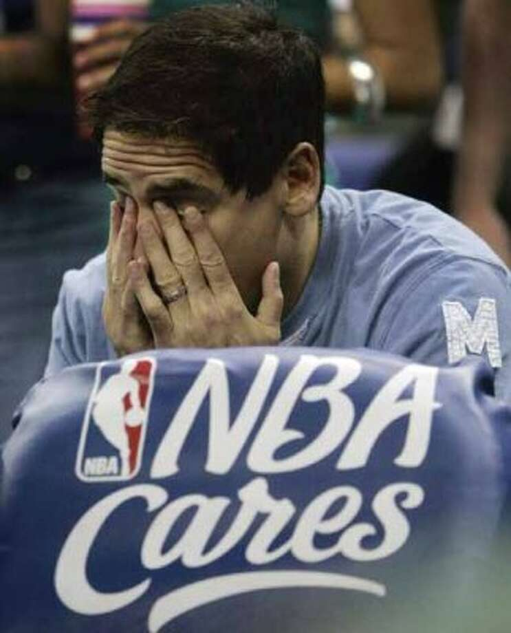 Dallas Mavericks owner Mark Cuban rubs his eyes late in the fourth quarter of the Mavericks' Game 5 against the New Orleans Hornets in the first round of the NBA basketball playoffs Tuesday, April 29, 2008, in New Orleans. Dallas lost to New Orleans 99-94 and was eliminated from the playoffs. (AP Photo/Bill Haber) (Bill Haber / AP)