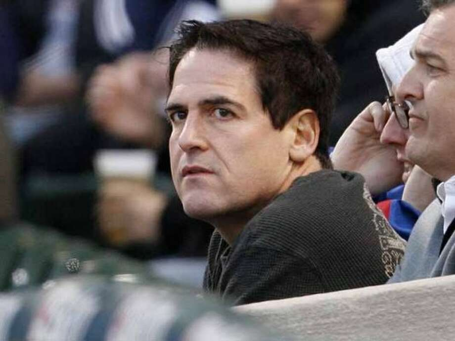 Mark Cuban, owner of the Dallas Mavericks NBA basketball team, watches the Chicago Cubs play the Milwaukee Brewers in the first inning of a baseball game Wednesday, April 30, 2008, in Chicago. (AP Photo/Nam Y. Huh) (Nam Y. Huh / AP)