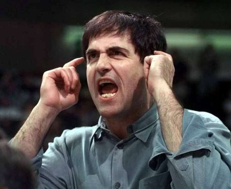 Dallas Mavericks owner Mark Cuban yells to guard Steve Nash  during the fourth quarter against the Charlotte Hornets in Dallas, Thursday, Feb. 3, 2000. The Mavericks won 106-96. (AP Photo/Bill Janscha) (BILL JANSCHA / Associated Press)